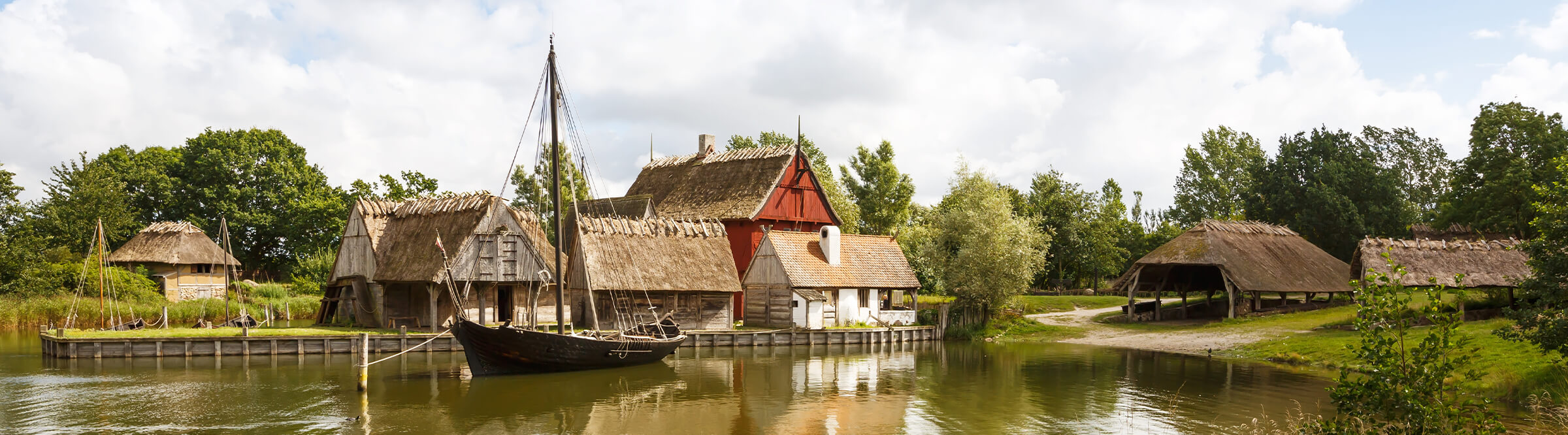 The medieval houses and boats in The Middle Ages Center, the experimental living history museum in Sundby Lolland, Denmark.