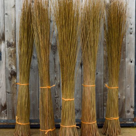 Green Willow Bundle, approx. 1 m to 2.5 m tall by 35 cm diameter. Natural, dried weaving material