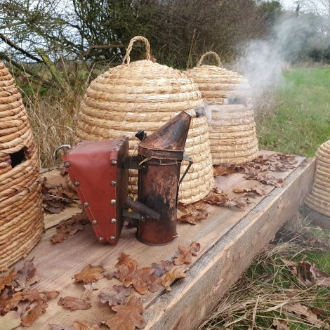 Straw Bee Skeps x 6, Skep table and 2 x bases. Bee smoker.Rental Only