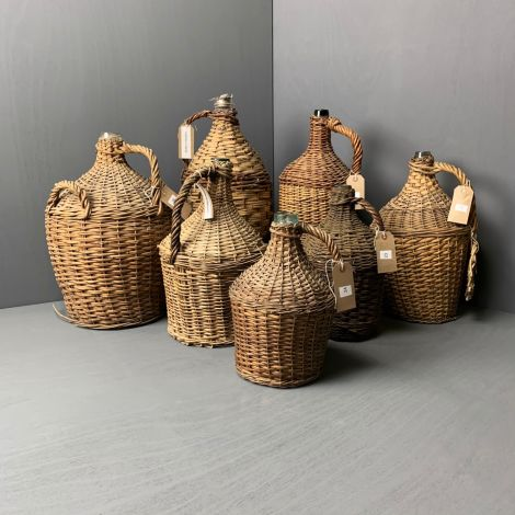 Woven Wicker Wrapped Bottles, RENTAL ONLY, 37 available. Beautifully aged and patinaed