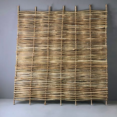 Hazel Hurdle, approx. 6' (1.8 m) wide with heights from 1' (30 cm) to 6' (1.8 m). Craftsman made from coppiced hazel