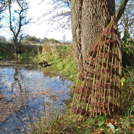 Fish Trap, hand woven willow, approx. 4', 1.2 m tall by 1', 30 cm diameter. Hand woven and authentic removable 'throat'