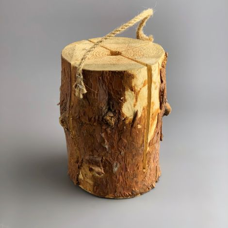 Sweedish Campfire Log, approx. 18 cm tall by 25 cm diameter.  Complete with matches and toasting fork.