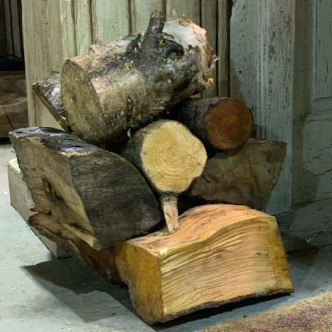 "Firewood Logs, cut and split, approx. 9"" by 5"" pieces supplied in a 1.2 m cubed bag."
