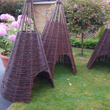 "Wigwam, hand woven willow, approx. 6'6"" (1.9 m) tall by 4' (1.2m) diameter. 3' (1m) opening"